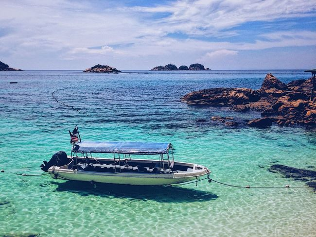 EyeEmNewHere Outdoors Beauty In Nature No People Nature Sea Island Boat Clear Water Qetags EyeEmNewHere