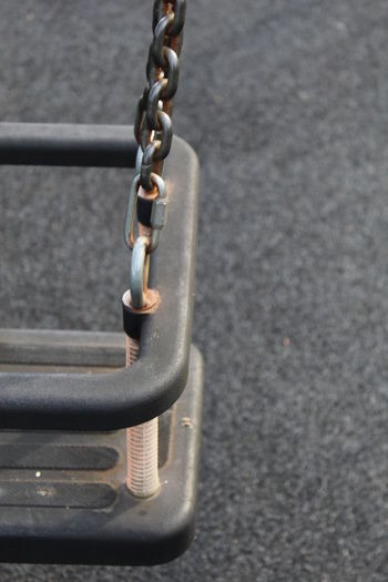 Chain Chain. Children. Childs Swing. Close Up. Close-up Day Detail Grey Colour. LINKS. Metal Metal. Metallic No People One Swing. One.In.A.Million Part Of Part Of A Childs Swing. Play.n. Playground. Single