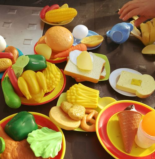 Food And Drink Food Citrus Fruit Fruit Freshness Healthy Eating Indoors  Table Sweet Food Large Group Of Objects Bread Variation No People SLICE Healthy Lifestyle Ready-to-eat Multi Colored Day Kids Playing Kids Hand Kids Having Fun Kid Hand  Outdoor Life Burger And Fries
