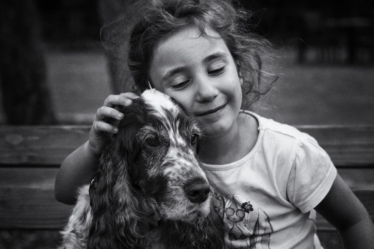 Girl with dog on bench