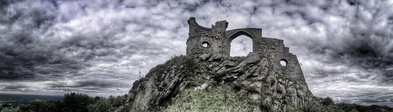 Castle against cloudy sky