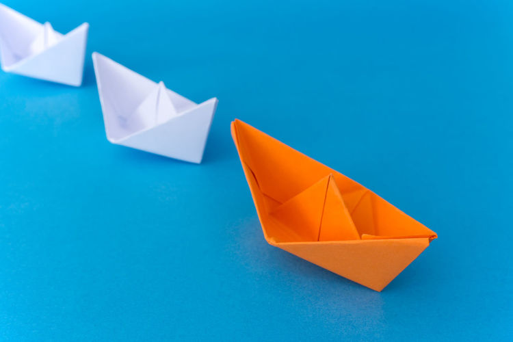 Close-up of origami over blue background