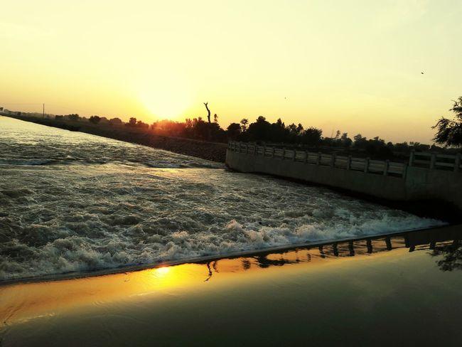 Water Reflections Riflectionswater Canalporn Sunset_collection Mobilephotography Eyeem Pakistan Nawanlahore Beautiful Sunset In Pakistan InPakistan Open Edit