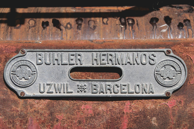 Barcelona Machinery Brand Capital Letter Close-up Hermanos Buhler Manufacturer Metal No People Old Rusty Sign Technology Text Uzwil Weathered Western Script