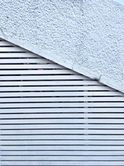 Corrugated Iron Building Exterior White Color Built Structure Textured  Architecture Backgrounds Outdoors Air Duct Pattern Pipe - Tube Shutter No People Day Sheet Industry Close-up Kosovo PRISHTINA Perspectives On Nature