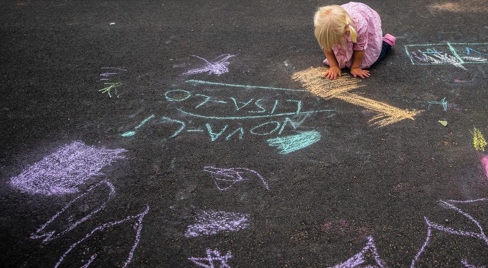 Child Playing On Street