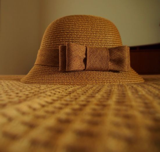 Close-Up Of Straw Hat On Table