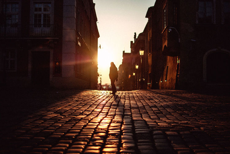 Full Length Of Silhouette Man Standing On Footpath During Sunrise