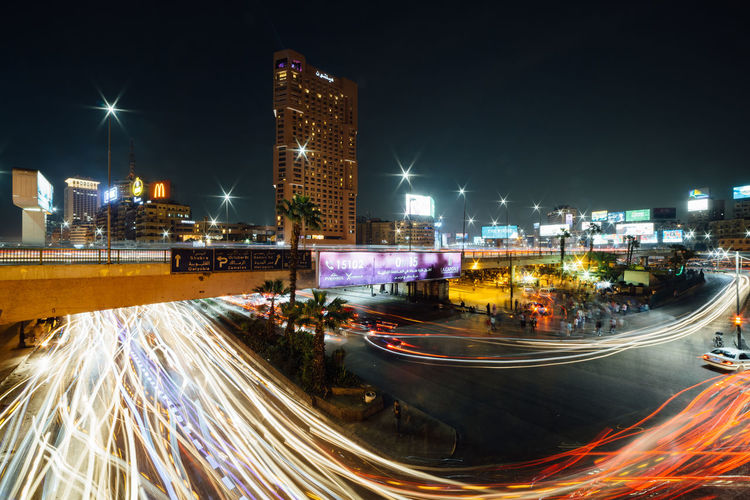Cairo, Egypt - November 8, 2018: The busy Abdel Munim Riad square and bus station in central Cairo at night, long exposure with traffic light trails. Night Illuminated Building Exterior Built Structure Architecture Motion City Long Exposure Light Trail Blurred Motion Office Building Exterior Speed Building City Life Street Transportation Skyscraper Road Cityscape Modern Outdoors Cairo Egypt