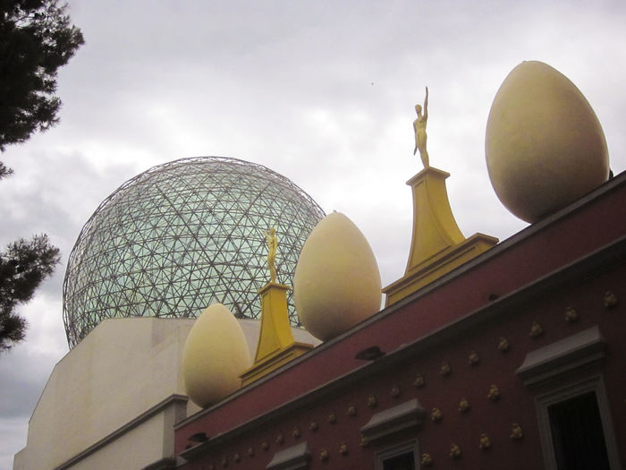 Salvador Dalí Theatre and Museum. The museum of the artist Salvador Dalí in his home town of Figueres, in Catalonia, Spain. Dali is buried there in a crypt below the stage. Architecture Art Artist Artistic Cloud - Sky Crypt Cultures Dome Figueres Figueres, Spain Low Angle View Memories Modern Mosque Museum Of Modern Art No People Outdoors Place Of Worship Religion Salvador Dali Sky Spire  Spirituality Stupa Temple - Building