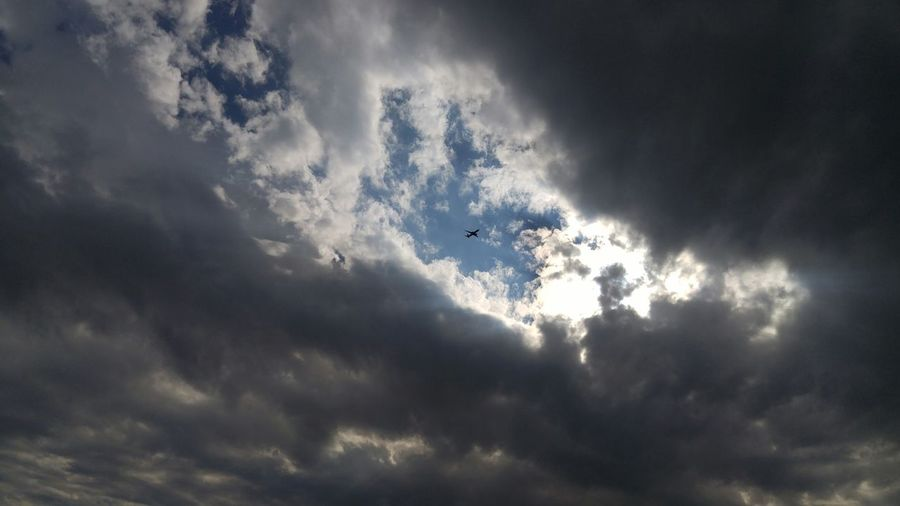 Airplane B Backgrounds Break In Storm Cloud - Sky Flying Hole In Clouds Low Angle View No People Plane Plane In Clouds Sky Tranquility