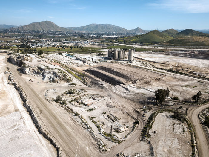 The CalPortland Aggregate plant in Colton Environment Sky Landscape Day Nature Industry No People High Angle View Outdoors Scenics - Nature Land Fuel And Power Generation Mining Quarry Aggregate Cement Plant Construction Earth Towers Storage Construction Industry