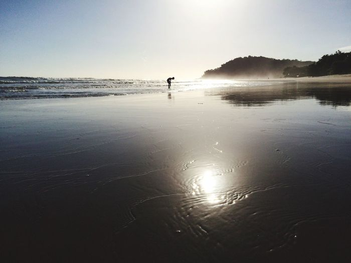 Reverências à natureza Water Beach Nature Sea Beauty In Nature Outdoors Real People Reflection Silhouette Sand Tranquility One Person Clear Sky People