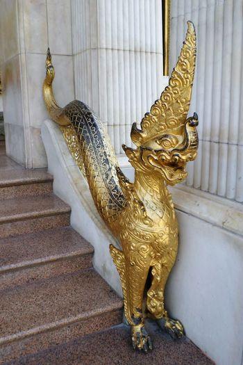 Statue in Wat Thai Photo. Statue Gold Colored Bangkok Thailand.. Thailand Photos Thai Temple Wat Thai Tods Tada Wat Travel Tradition History Photo Thailand Backgrounds City Bangkok Thailand. Architecture Statue Thai Style