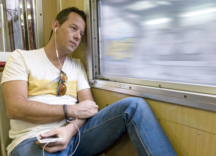 Young man sitting in train