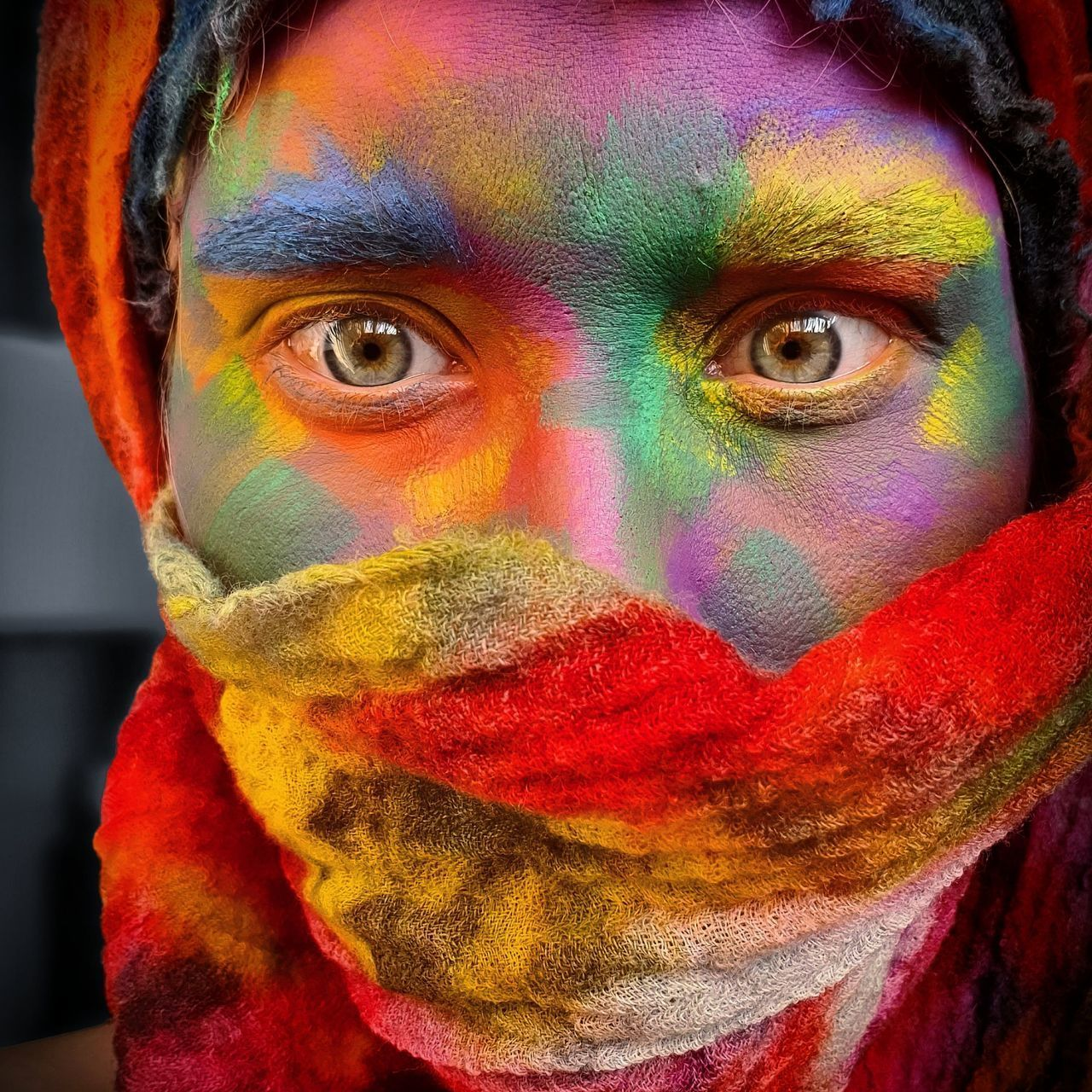 CLOSE-UP PORTRAIT OF A MAN WITH MULTI COLORED BACKGROUND