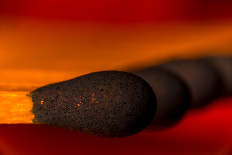 Close-up of matchsticks against red background