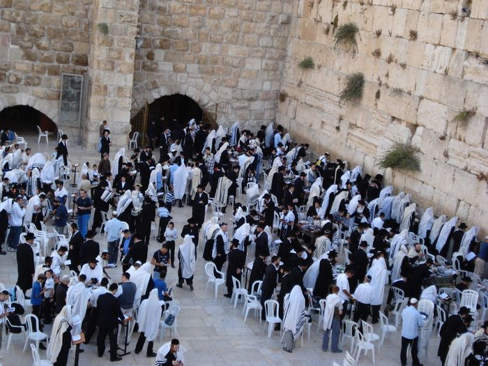 High angle view of people praying by western wall