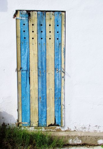 Wooden Door Building Exterior Sun Bleached Timber Blue Yellow Stripes In San Antonio Bay Ibiza.