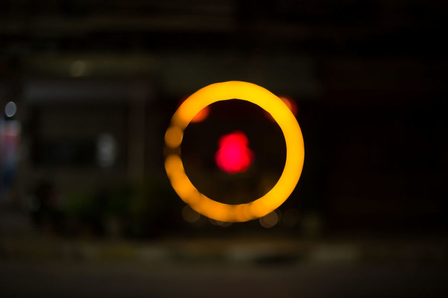 Background Bokeh Bokeh Circle Close-up Communication Electric Lamp Focus On Foreground Geometric Shape Glowing Illuminated Light Light - Natural Phenomenon Nature Night No People Orange Color Outdoors Road Shape Sign Sunset Transportation Yellow