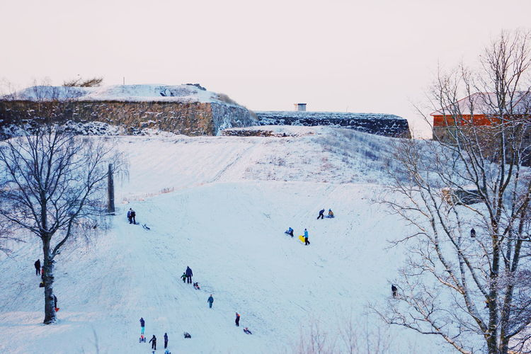 High angle view of people on snow covered landscape