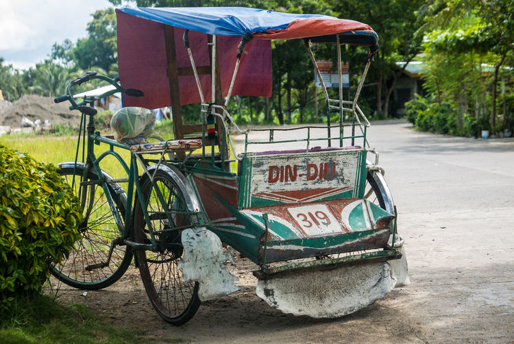 Rickshaw parked by road
