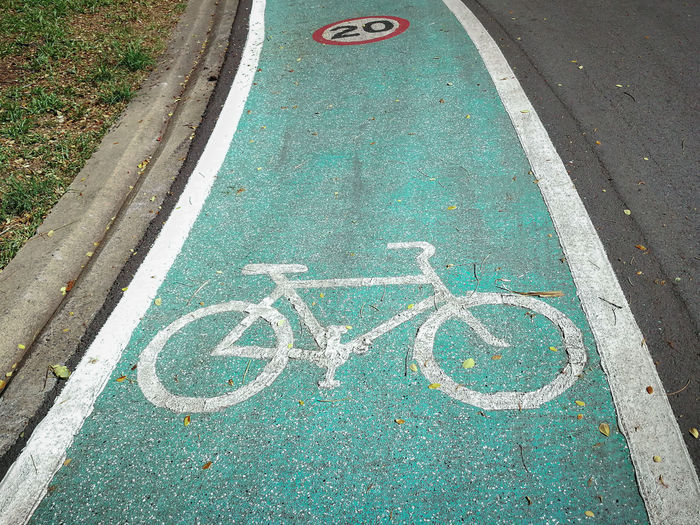 High angle view of bicycle lane sign