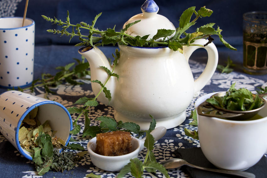 A jar of fresh mint tea, mint and a honeycomb Honeycomb Ceramics Close-up Crockery Cup Drink Floral Pattern Flower Flowering Plant Focus On Foreground Freshness Herb Mug Nature No People Peppermint Plant Peppermint Tea Plant Plant Part Potted Plant Refreshment Still Life Table Tea Cup Teapot