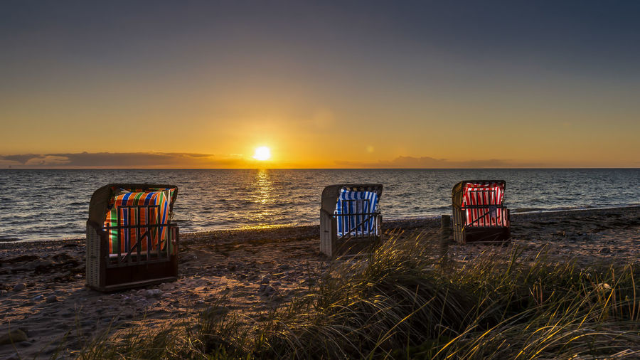 Baltic Sea Beach Beach Chairs Beauty In Nature Day Flashlight Horizon Over Water Horizontal Landscape Nature No People Outdoors Photography Themes Postcard Relaxation Sea Sky Sunset Tourism Travel Travel Destinations Vacations Water