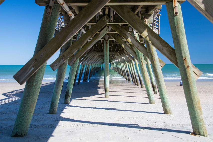 Pier at Myrtle Beach State Park Architectural Column Architecture Beach Built Structure Day Diminishing Perspective Direction Horizon Over Water In A Row Land Long Nature No People Outdoors Pier Sea Sky Sunlight The Way Forward Underneath Water Wood - Material