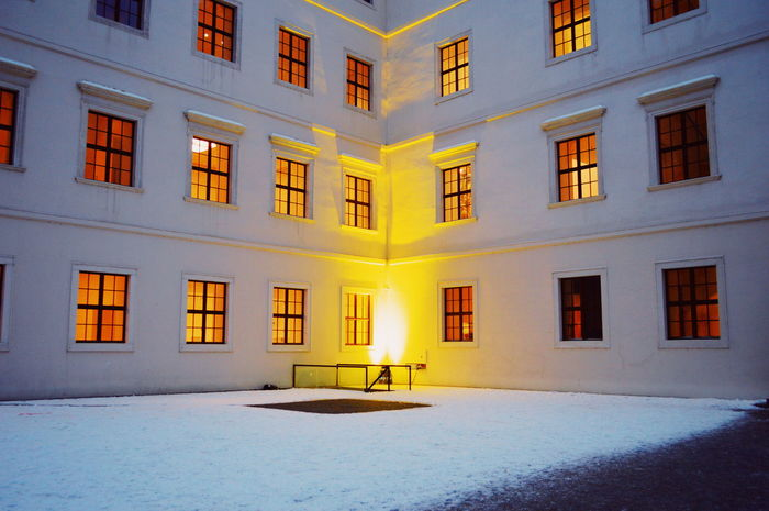 Urban Urbanphotography Urban Perspectives Symmetry Window Geometry Architectural Feature Architectural Detail Repetition Building Exterior Many Yellow White Winter Snow Illuminated Window Architecture Building Exterior Built Structure Historic Cold Temperature Weather Condition Architecture And Art Architectural Design