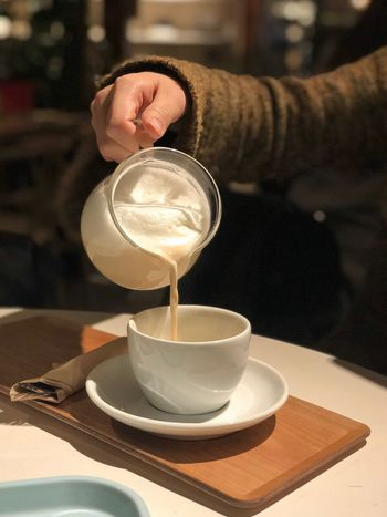 Drink Food And Drink One Person Human Hand Refreshment Real People Focus On Foreground Table Coffee - Drink Holding Cafe Freshness Close-up Saucer Drinking Glass Lifestyles Plate Frothy Drink Human Body Part Indoors