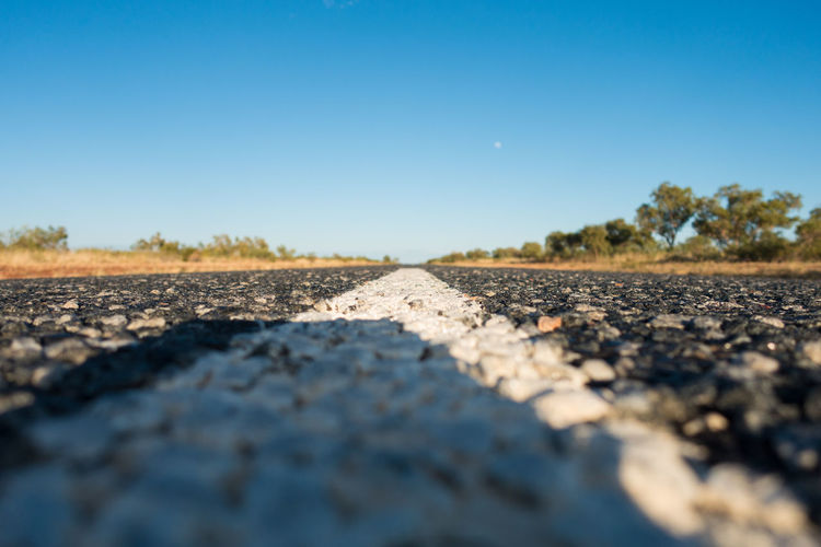 Road stretching into distance from ground level Outdoors Perspective Road Surface Level