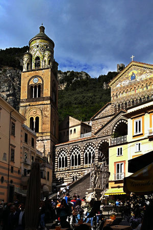A view of the central square of Amalfi, with its cathedral and bell tower. Amalfi Coast Bright Cathedral Tourist Toursim Architecture Bell Tower Building Exterior Built Structure Cloud - Sky Day Large Group Of People Men Outdoors People Place Of Worship Real People Religion Sky Spirituality Sun Tourism Destination Toursims Attraction Travel Destinations Women