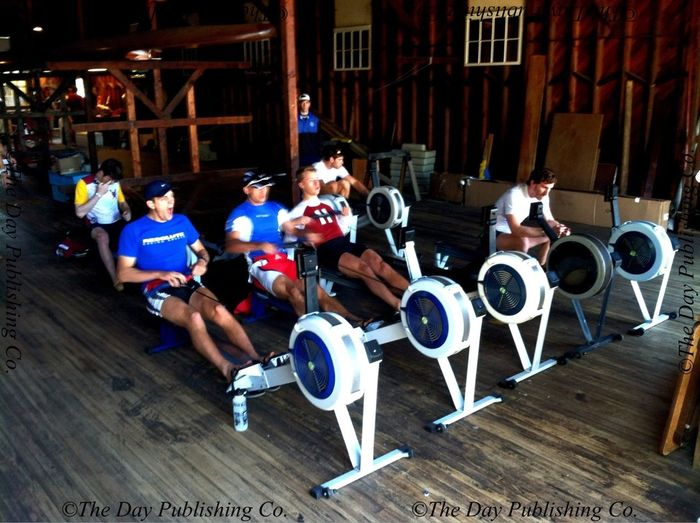 Rowers warm-up on the ergs.