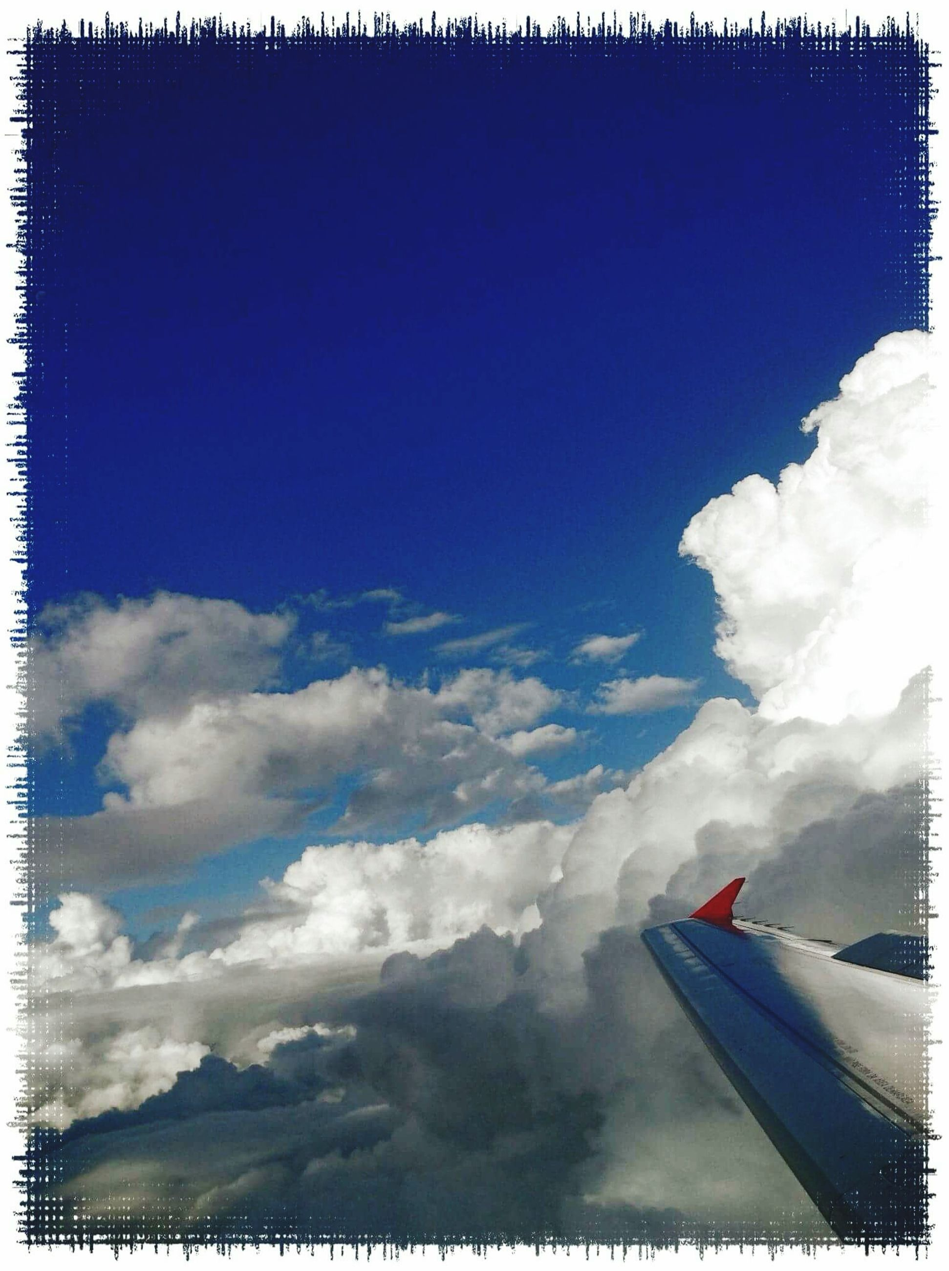 transfer print, auto post production filter, sky, cloud - sky, beauty in nature, cloud, scenics, nature, blue, airplane, tranquil scene, transportation, tranquility, no people, white color, day, outdoors, cloudy, cloudscape, flying
