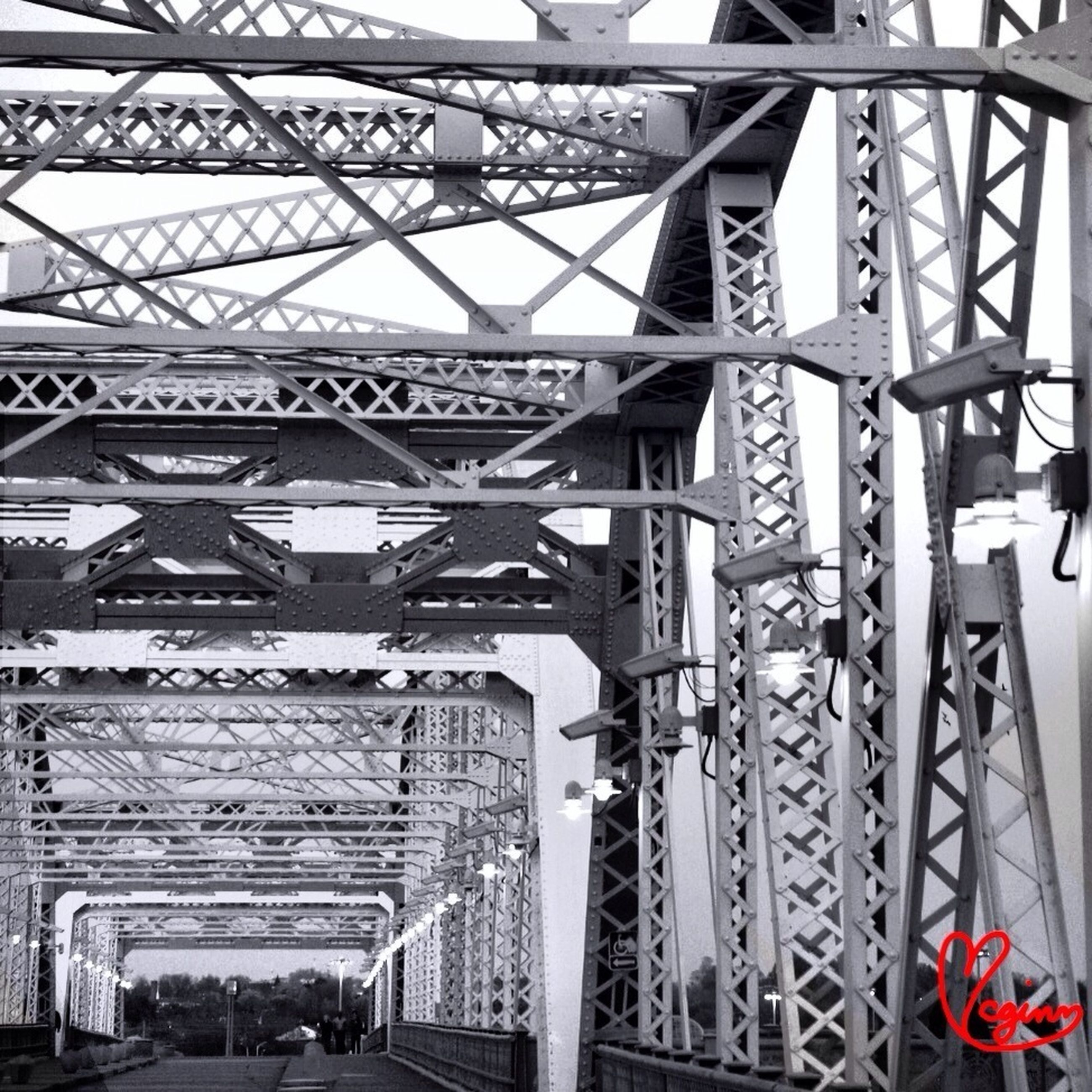 architecture, built structure, metal, low angle view, metallic, connection, building exterior, railing, bridge - man made structure, transportation, engineering, day, rail transportation, no people, outdoors, clear sky, sky, travel destinations, pattern, travel