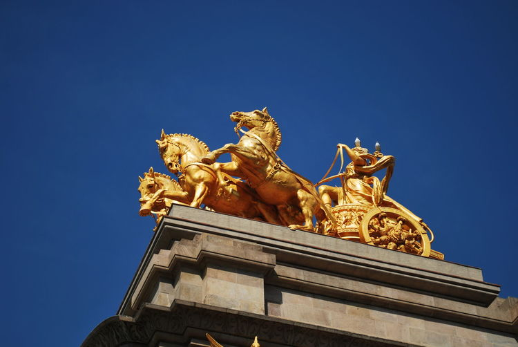 Architecture Barcelona Barcelona, Spain Building Exterior Built Structure Catalonia Catalunya City City Gate Cityscape Clear Sky Concert Hall  Day Gold Horse Human Representation No People Outdoors Sculpture Sky Statue Tourism Travel Travel Destinations Urban Skyline