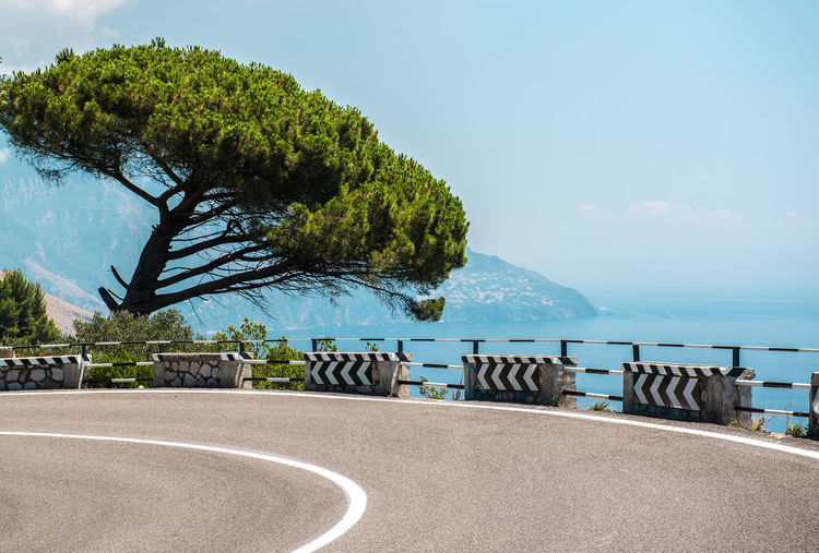 The road along the Amalfi Coast. Italy Amalfi Coast Beauty In Nature Campania Coast Curve Highway Holiday Idyllic Italy Landscape Mediterranean Sea Nature Outdoors Picturesque Positano Scenery Seaside Summer Summertime Sunny Day Tourist Resort Travel Destinations Tree Vacations Winding Road