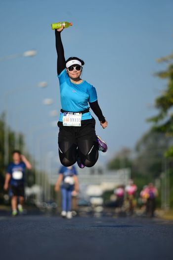 One Person Jumping Full Length Mid-air Real People Lifestyles Leisure Activity Day Sport Human Arm Casual Clothing Nature Focus On Foreground Front View Sky Arms Raised Motion Vitality Outdoors Marathonrunner Running Marathon Marathon Runner Zero Gravity Hanging On Air