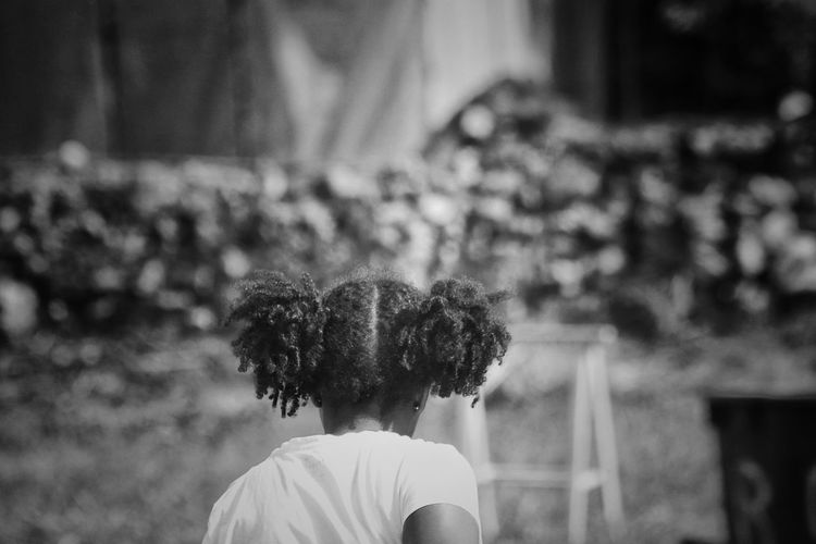 Rear view of girl with pigtails playing at park