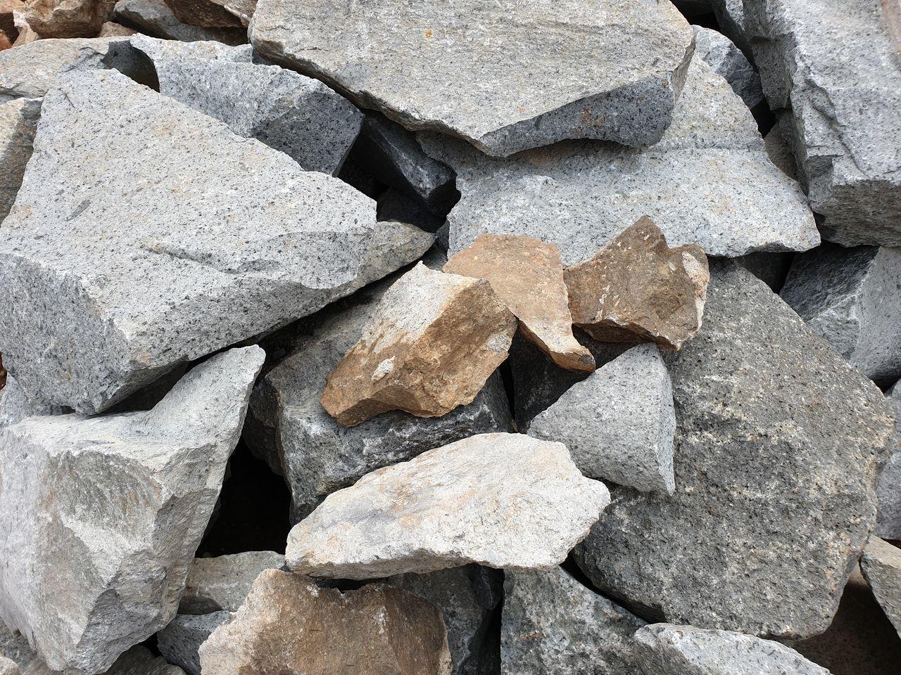 FULL FRAME SHOT OF ROCKS ON CONCRETE