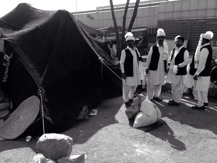 Real People Occupation Outdoors Full Length Men Day A Traditional Dance Group Of Iran Standing By Their Tent