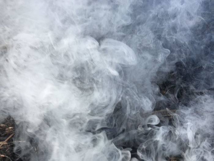 Aerial view of smoke against black background