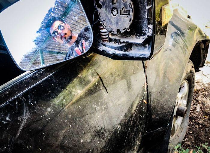 Portrait of teenage boy seen through car windshield