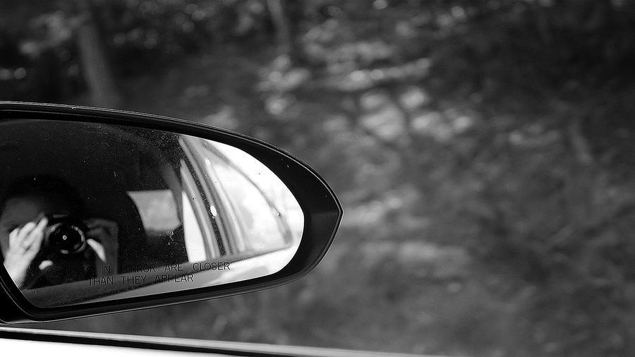 Young womans reflection as she is taking a photo Art is Everywhere Dirty Mirror EyeEm Best Shots - Black + White EyeEm Gallery Looking In The Mirror Beautiful Woman Best Vacation Blackandwhite Blurred Background Close-up Eye4photography  Eyeem Travel Focus Focus On Foreground Mirror One Person Outdoors Photography Photography Themes Reflection Reflections Side-view Mirror Vehicle Mirror Woman Hand Young Women The Traveler - 2018 EyeEm Awards EyeEmNewHere The Still Life Photographer - 2018 EyeEm Awards The Street Photographer - 2018 EyeEm Awards The Portraitist - 2018 EyeEm Awards The Great Outdoors - 2018 EyeEm Awards