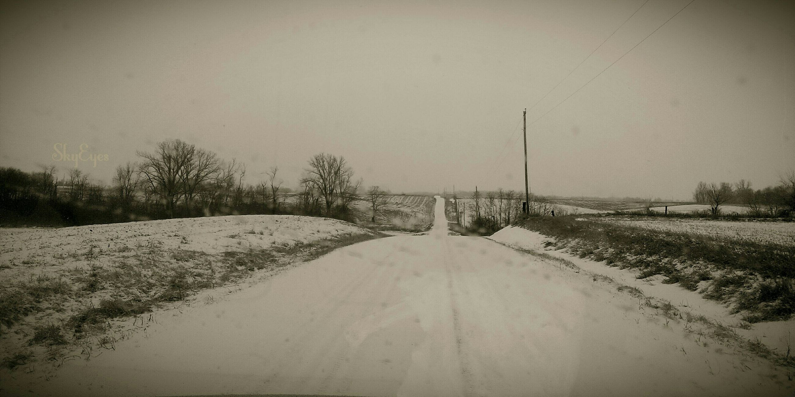 the way forward, tranquil scene, tranquility, landscape, winter, snow, cold temperature, field, clear sky, copy space, nature, weather, diminishing perspective, scenics, beauty in nature, road, vanishing point, non-urban scene, tree, empty