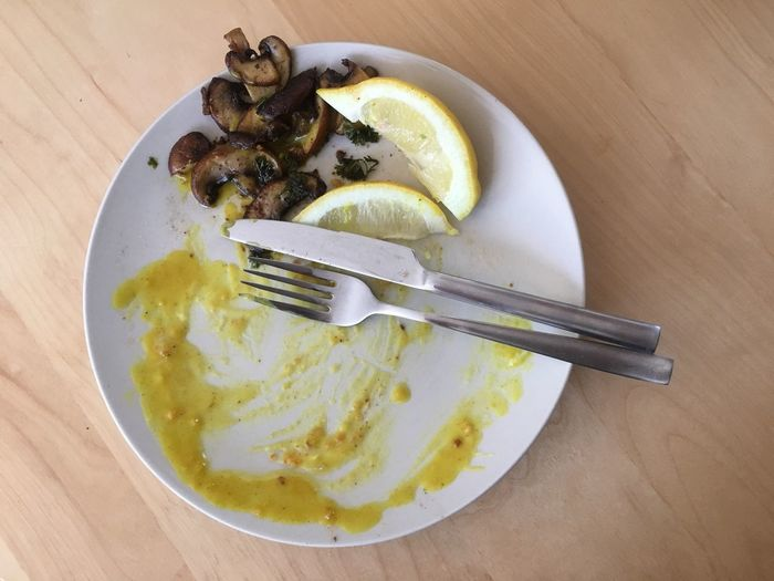 Empty plate with lemon and silvery Fork Plate Table Food And Drink Food Freshness Eaten Restaurant Silvery No People