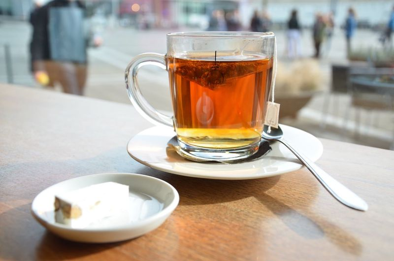 Close-up of tea with sweet food on wooden table