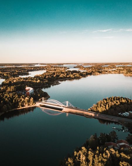High angle view of bridge over sea in city against sky
